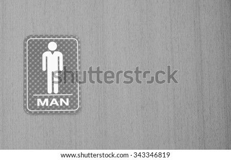 Back and White man toilets sign for public restroom on a wood wall. - stock photo
