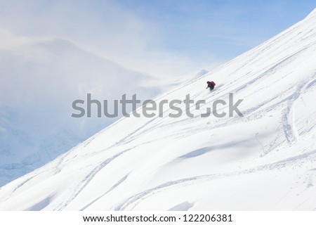 Back-country skier on wide open slope. - stock photo