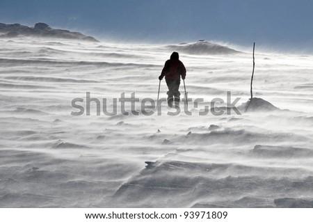 Back country skier (ski touring), walking up to a snowed mountain - stock photo