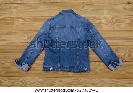 Back Denim jacket on wooden background