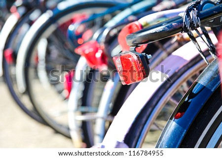 Back detail of bikes parked in a centre street of Amstersam. - stock photo