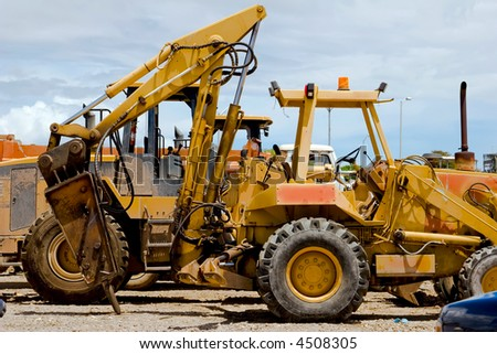 Back end of a backhoe with the jackhammer attachment - stock photo
