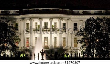 Back facade of the White House at night - stock photo