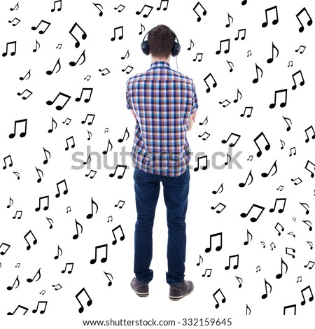 back full length view of teenage boy listening music with headphones isolated on white background - stock photo