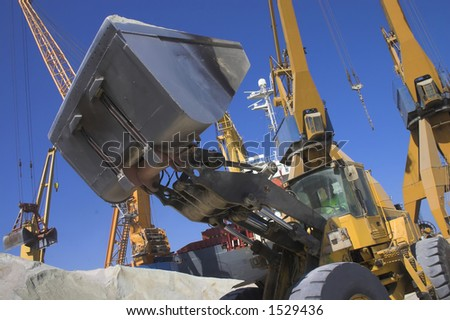 Back Hoe and cranes - stock photo