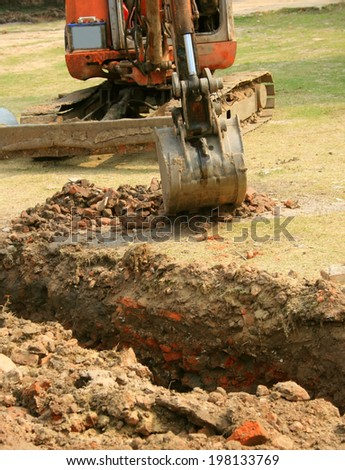 back-hoe in operation - stock photo