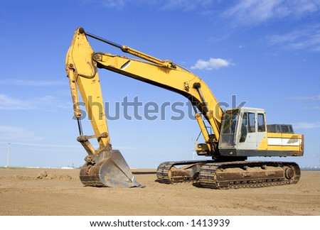 Back hoe on a work site - stock photo