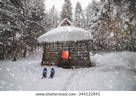 Back in the wild forest, among the legendary mountains of Eastern Europe Ukraine- are houses of shepherds and hunters, covered with snow, where tourists rarely come travelers climbers to the top  - stock photo