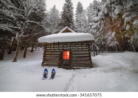 Back in the wild forest, among the legendary mountains of  Ukraine- are houses of shepherds and hunters, covered with snow, where tourists rarely come travelers climbers to the top of Montenegro - stock photo