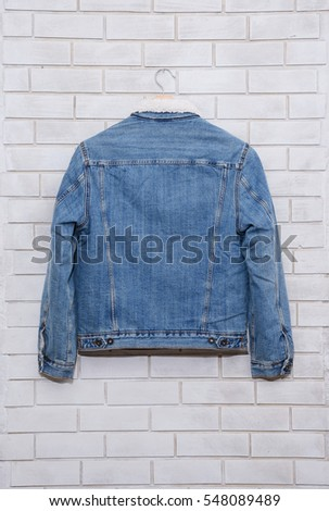 Back jean shirt is on clothes-hanger