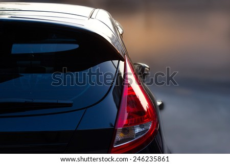 Back light of city car on the street background  - stock photo