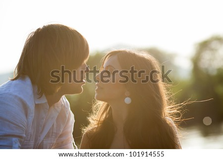 Back light portrait of two lovers on the beach - stock photo