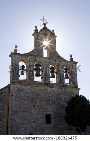 Back lighting view of the belfry of an old church in Segovia, Castilla and Leon, Spain.  Belfry - stock photo