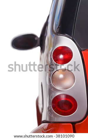 Back lights of a modern car isolated on white background - stock photo