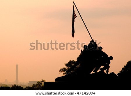 back lit Marine Corps War Memorial Iwo Jima statue and American Flag at sunrise