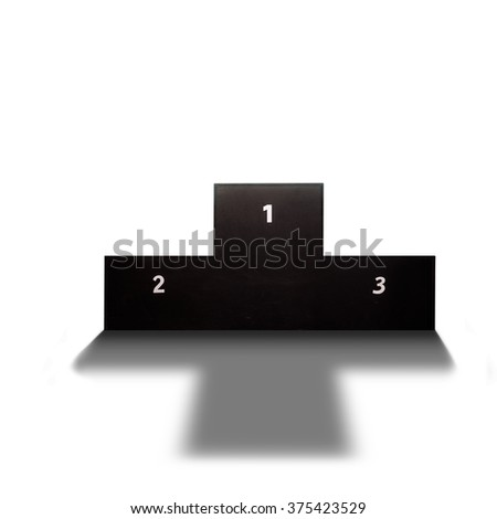 Back lit podium casting shadow in sports arena - stock photo