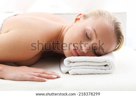 Back massage . Attractive blonde woman in the office spa, relaxes August waiting for a cosmetic procedure.  - stock photo