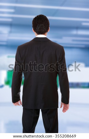 back of a business man in suit at the office lobby
