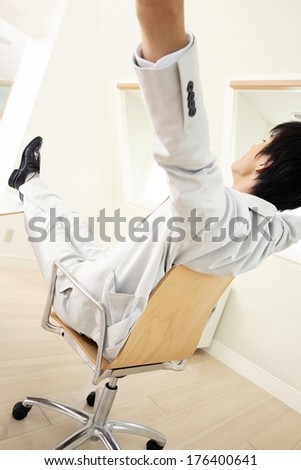 Back of a Japanese businessman stretching out