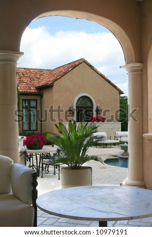 back of a luxury Italian style home and pool - stock photo