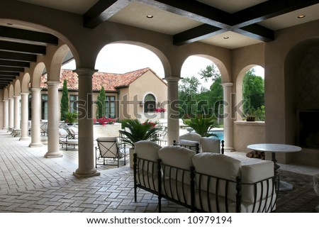 back of a luxury Spanish style home and pool - stock photo