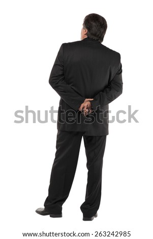 Back of a mature business man standing isolated on white background - stock photo