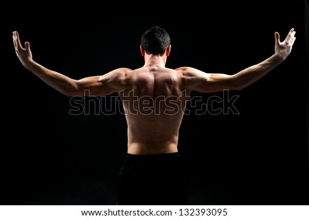 Back of a muscular man naked, studio shot
