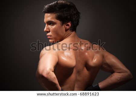 Back of a muscular man with relief mussels - stock photo