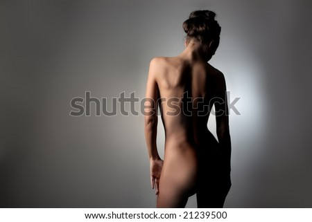 back of a naked woman - stock photo