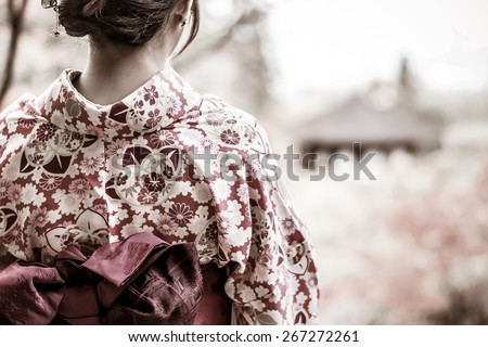 Back of a pretty Japanese girl in beautiful atmosphere in grunge style - stock photo