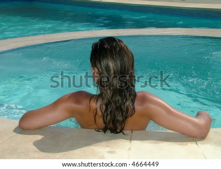 Back of a woman in a jacuzzi at a resort - stock photo
