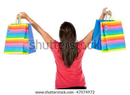Back of a woman with shopping bags isolated over a white background