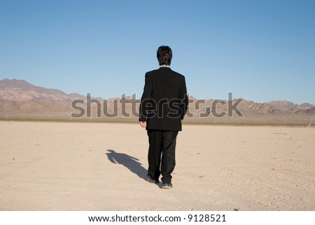 Back of a young businessman outdoors - stock photo
