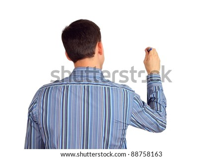 Back of a young man in a blue striped shirt writing or drawing something