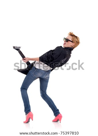 back of an energic blond girl wearing glasses and playing a guitar - stock photo