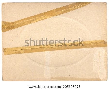 Back of an old photgraph with yellowed tape and embossing - stock photo
