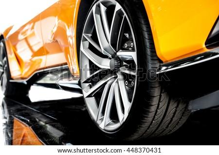Back of an orange modern sport car - stock photo
