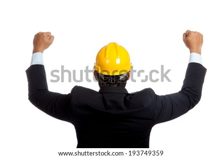 Back of Asian engineer man rise both fists up for success isolated on white background