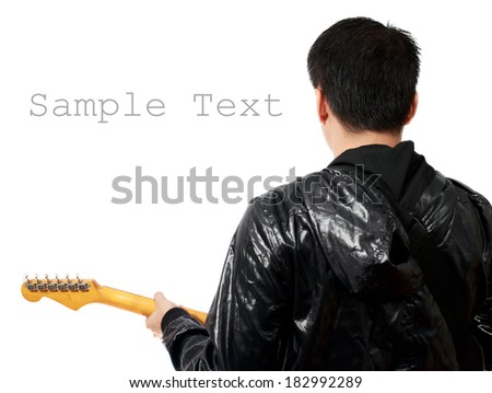 back of Asian handsome musician plays electric guitar isolated - stock photo