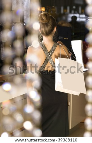 back of beautiful rich lady in the boutique - stock photo