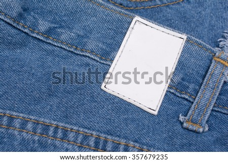 Back of blue jeans with leather label - stock photo