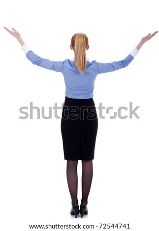 Back of business woman holding her hands in the air, isolated - stock photo