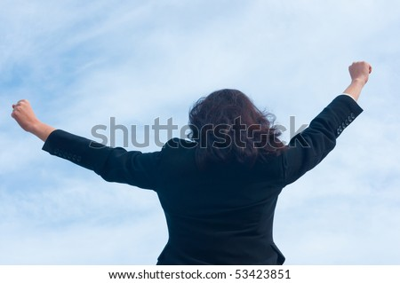 Back of business woman with hands up - stock photo