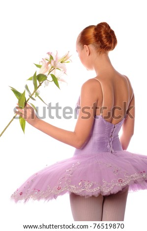 back of calm red-haired ballet dancer with lily isolated on white - stock photo