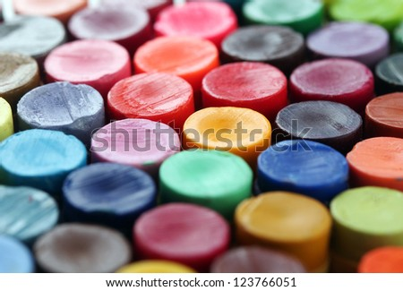 Back of colorful crayon pencils set  together arranged to display their vivid and bright colors - stock photo