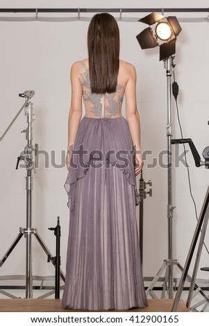 Back of elegant outfit with purple dress - stock photo