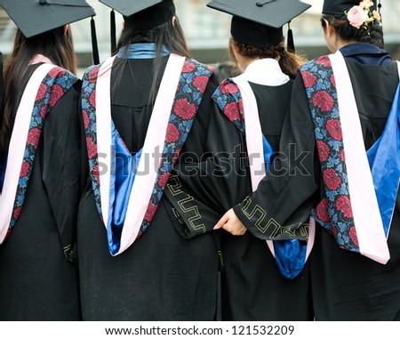 back of graduates on graduation day. - stock photo