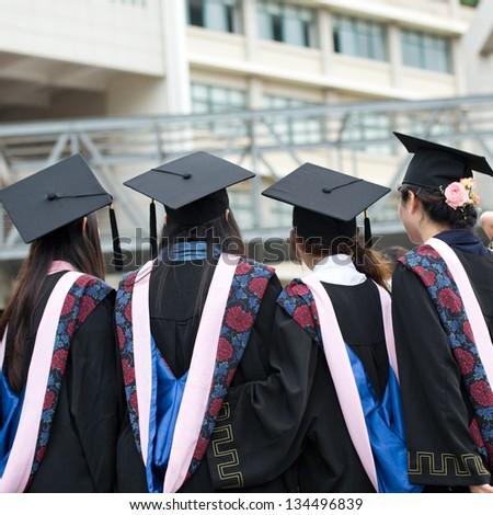back of graduates on graduation day. - stock photo