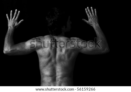 Back of muscular athletic young man over black background