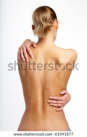 back of nude beautiful girl on white background. - stock photo
